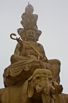 Big golden Buddha waiting on the summit