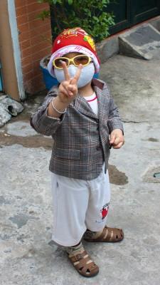 Little Vietnamese kid with Santa Claus hat