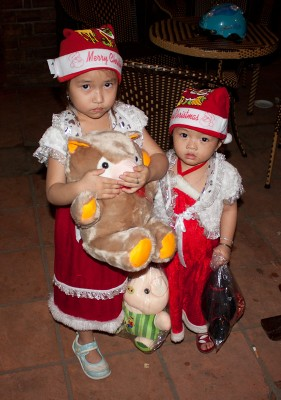 Vietnamese kids dressed as Santa Claus