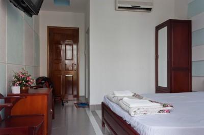 My room at the Sen Vang Guesthouse in Nha Trang. 7 USD per night.