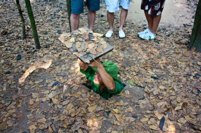 Cu chi tunnels, Vietnamese guide showing us how to enter the tunnels