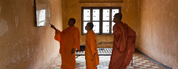 Buddhist monks visiting the Tuol Sleng Genocide museum