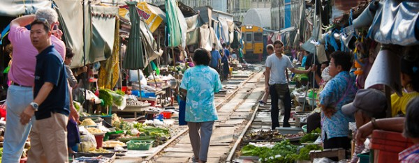 6 times a day the train passes through the Maeklong railway market