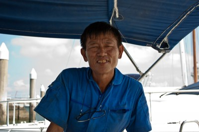 Our mechanic at the Raffles Marina